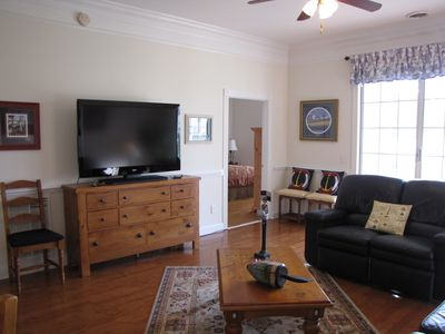Living area with 55in flat screen T.V. with slight view of master bedroom