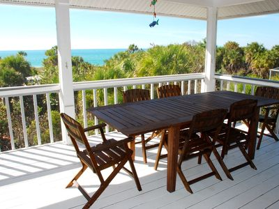 Outdoor dining with a spectacular view on the screened upstairs porch
