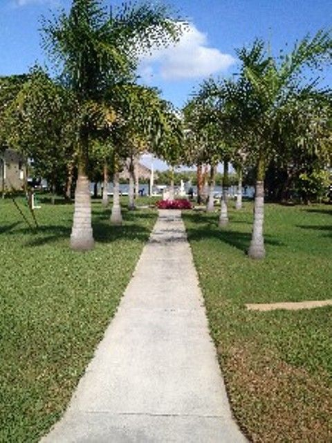 Private bay front lot with dock and slips.