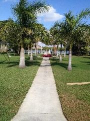 Fort Myers Beach cottage photo - Private bay front lot with dock and slips.
