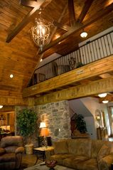 Seven Springs house photo - Loft above Great Room. Loft offers sleeper sofa. All custom wood ceilings