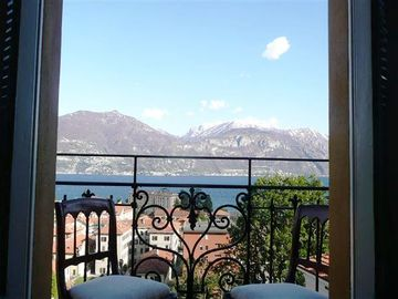 French doors open out on to the lakeview balcony at Menaggio Castello Terzo