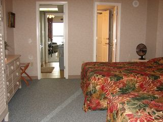 Ocean Dunes condo photo - Bedroom, Kitchen on left, 1 full and a 1,2 bath on right.