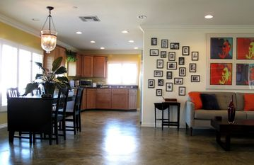 Spacious common area includes fully-equipped kitchen, dining, and living room.