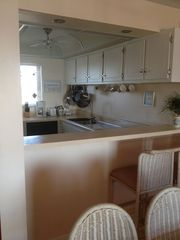 Okaloosa Island condo photo - Remodeled kitchen with new appliances, View of Intercoastal and Gulf.