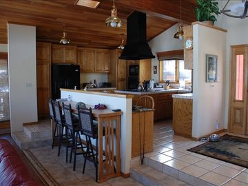 Spacious kitchen overlooking great foom w/ 4 seat bar.