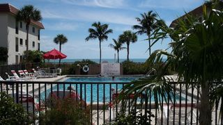 Sanibel Island condo photo - Relax and Unwind in the Heated Pool