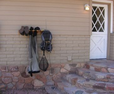 Payson cabin rental - A place to hang your fishing gear. Another rod holder is inside.