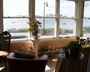 Boston villa photo - Sunroom overlooking harbor and Boston skyline