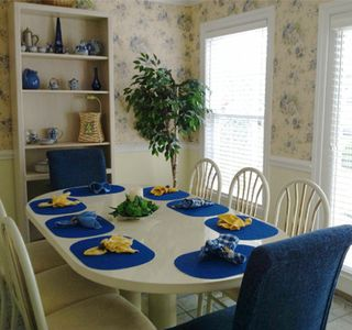 Dining room with sunny, Country French decor.