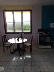 Isabela house photo - upstairs dining table