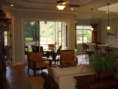 Living room and Lanai and view to 18th Fairway