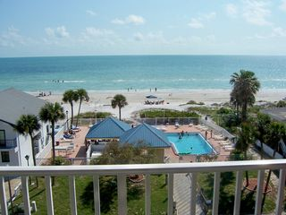 Redington Shores condo photo - Your balcony is close to the pool and beach, but far enough for relaxing quiet.