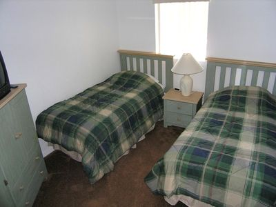 Third bedroom has two twin beds, cable TV and walk-in closet