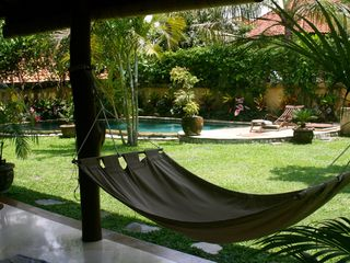 Sanur house photo - Verandah hammock hanging from teak tree posts, with pool behind.