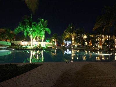 view of pool area at night