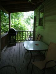 Galveston cottage photo - Back Covered Deck - Grilled burgers anyone?