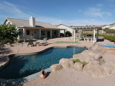 Enjoy the pool, outdoor kitchen, and putting green