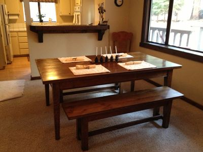 Dining room. Sits between kitchen and livingroom. Handcrafted old wood table.