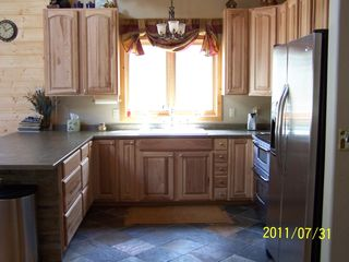 Kitchen, look at that large counter island! Great for baking cookies. - Williams house vacation rental photo