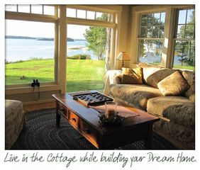 A wall of windows overlooks Middle Bay - Harpswell cottage vacation rental photo