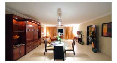 Puerto Plata condo rental - Inside the middle cherry cabinet is the queen-size Murphy bed.