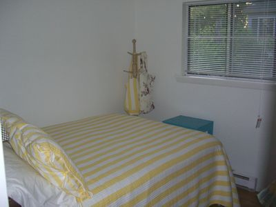 This bedroom has a comfortable queen size bed, one dresser and a/c.
