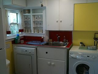 Northport cottage photo - Kitchen sink, washer and dryer
