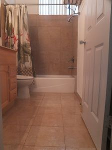 Marble tub/shower and floor.