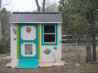 Dripping Springs house photo - Backyard playhouse, with a sand and seashells for excavating!