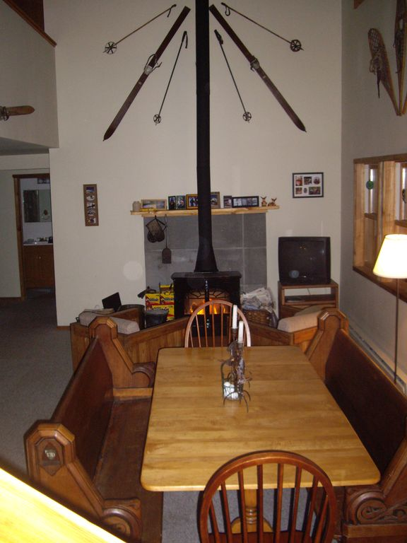 Dine under a 24' vaulted ceiling, with a fire blazing in the wood stove.