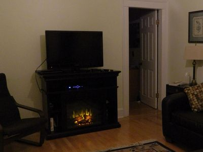 Flat screen TV with cozy electric fireplace.