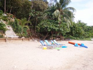 Roatan house photo - The neighborhood beach located 50 meters to the south of The Pink Orchid