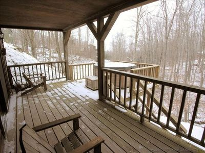 Hot tub overlooking bubbling brook and beautiful woods off covered deck