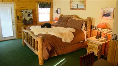 Beautiful Aspen log king bed. The master bedroom is huge with an outside porch