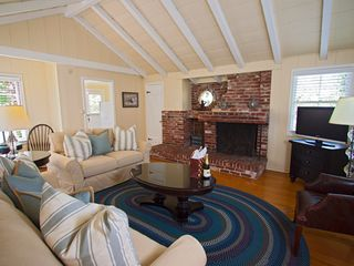 Carmel cottage photo - Living room with fireplace and sofa sleeper.