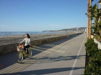 Bike riding along the 3 mile Mission Beach-Pacific Beach boardwalk.