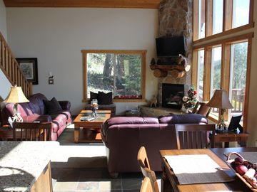 The family room sits 6 adults comfortably; 42-inch HDTV/DVD over fireplace