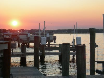 Sunset over the water -- see both sunrises and sunsets from this cottage