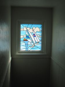 Stainglass window over stairs