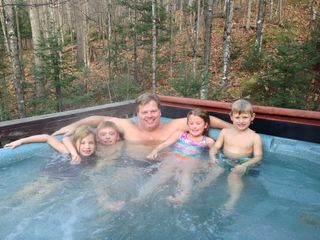Iron River chalet photo - A large hot tub that can accommodate 6-8 adults (kids not included).