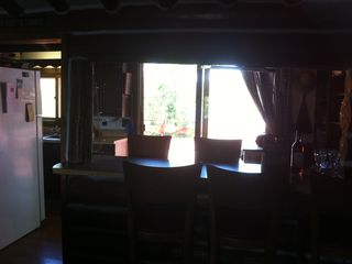 Michigamme River cabin photo - The kitchen bar overlooks the deck and is next to the galley kitchen