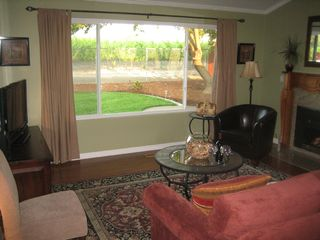 Napa house photo - Family Room with great view of vineyard. Gas fireplace for romantic evenings.