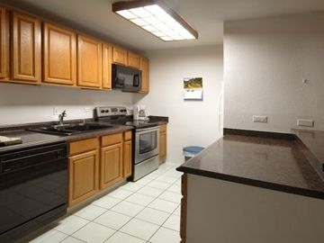 Recently renovated kitchen with oak cabinets new countertops and appliances