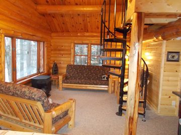 Marcell cabin rental - What a beautiful photo of the living room. The spiral staircase is to the loft.