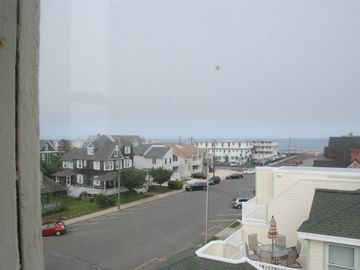"View of the ocean and Coral Street from the 4th Floor ""widow's watch."""
