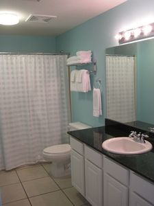 Main Bathroom with Access To Second Master Bedroom and Hall