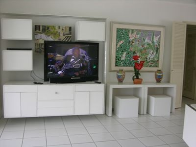 Living room with large screen television.