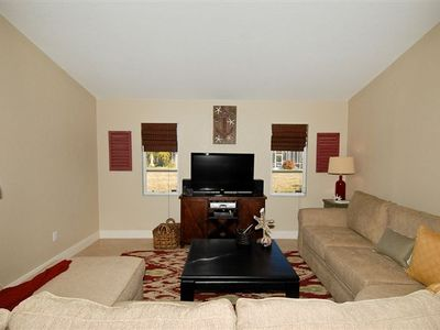 Comfy family room with flat screen, DVD, and Sony sound system.