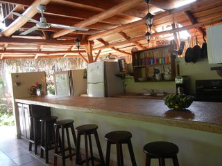 Nosara house photo - The Rancho kitchen and bar, engineered for good times